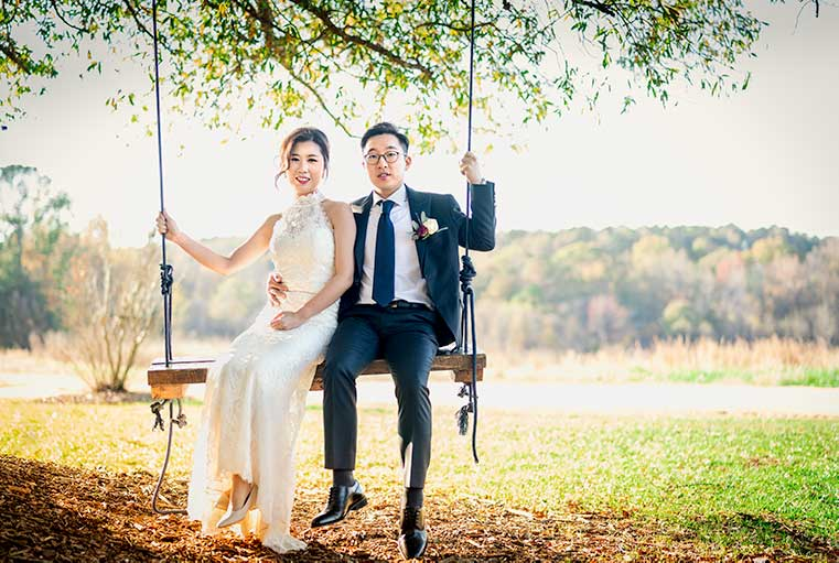Bride and Groom on the swing at The Meadows
